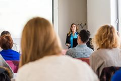 Business woman delivering a speach. Audience at a conference Royalty Free Stock Photo
