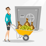 Business woman depositing money in bank in safe. Royalty Free Stock Images