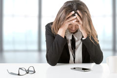 Business Woman Depressed At The Office Royalty Free Stock Photos