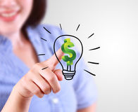 Business woman designate a lamp of finance idea Stock Photos