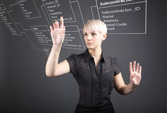 Business woman designs a new database. Programmer-woman designs a new database tables royalty free stock images