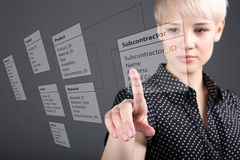 Business woman designs a new database. Programmer-woman designs a new database tables stock images