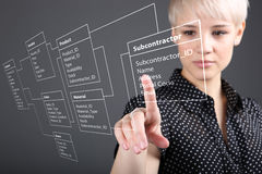 Business woman designs a new database. Programmer-woman designs a new database tables royalty free stock photo
