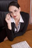 Business woman at desk Stock Images