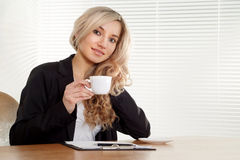 Business woman at a desk Stock Image