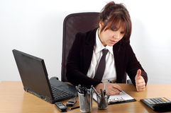 Business woman at desk #6. With laptop on white background Stock Photos