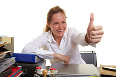 Business woman at desk holding Stock Images