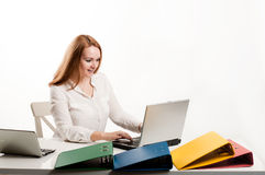 Business woman at  desk with a laptop Royalty Free Stock Photos