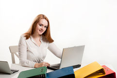 Business woman at  desk with a laptop Stock Images