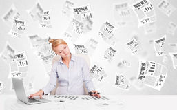 Business woman at desk with stock market newspapers Stock Photography