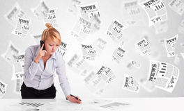 Business woman at desk with stock market newspapers Stock Image