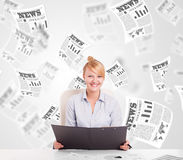 Business woman at desk with stock market newspapers Royalty Free Stock Photo