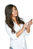 Business woman dialing up on her cell phone Royalty Free Stock Image