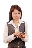 Business woman dials a mobile phone Royalty Free Stock Images