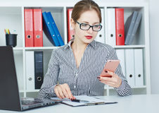 Business woman dials the phone number on mobile phone. Royalty Free Stock Photo