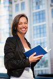 Business woman with diary Royalty Free Stock Photography