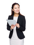 Business woman with digital tablet and look away Royalty Free Stock Images