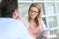 Business woman discussing with the client Stock Photo