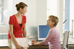 Business Woman Discussing At Desk Stock Images