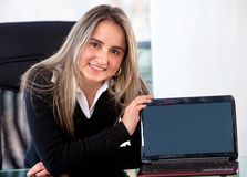 Business woman displaying laptop Stock Photos