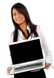 Business woman displaying a laptop Stock Photo