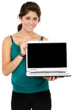 Business woman displaying a laptop Stock Images