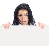 Business woman displaying with surprise a banner Royalty Free Stock Photography