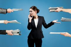 A business woman is distracted by employees on various issues
