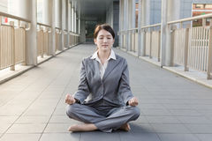 Business woman do lotus position Royalty Free Stock Photography