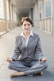 Business woman do lotus position Royalty Free Stock Photos