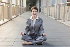 Business woman do lotus position Stock Image