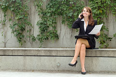 Business woman with document talks on smart mobile cell phone ou Royalty Free Stock Image
