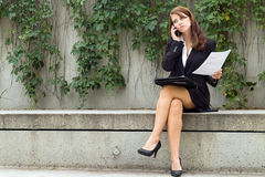 Business woman with document talks on smart mobile cell phone ou Royalty Free Stock Photography