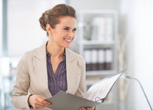 Business woman with documents in office Stock Photography