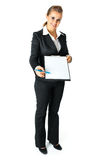 Business woman with documents for your sign. Full length portrait of friendly modern business woman with documents and pen for your sign isolated on white stock photo