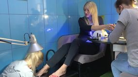 Manicure and Pedicure. Business woman does the combo procedure in the salon: Manicure and Pedicure stock footage