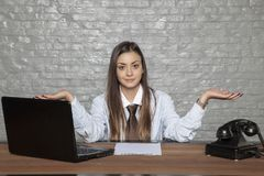 Business woman does not know whether to sign a contract or not Stock Image