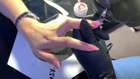 Manicure. Business woman does the  procedure in the salon: Manicure stock video footage