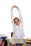 Business woman doing back exercises royalty free stock photo