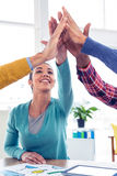 Business woman doing high five with team in creative office Stock Images