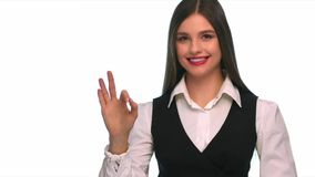 Business woman doing the ok sign and winks - isolated stock footage