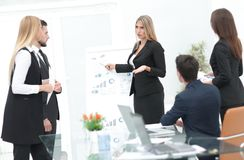 Business woman doing a presentation to his business team. Stock Photos