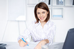 Business woman doing some paperwork in office Stock Photos