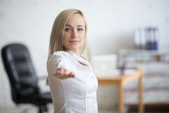 Business woman doing Warrior 2 Pose Royalty Free Stock Image