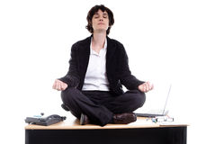 Business woman doing yoga on her desk Stock Image