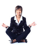 Business woman doing yoga. Royalty Free Stock Image