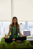 Business Woman Doing Yoga Meditation On Table In Office Stock Photo