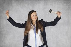 Business woman with dollar signs raises her hands in a gesture o Royalty Free Stock Photography
