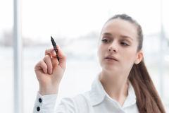 Business woman drawing a concept diagram Stock Images
