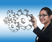 Business woman drawing gear to success Stock Photo